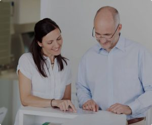 Man and woman looking at a document